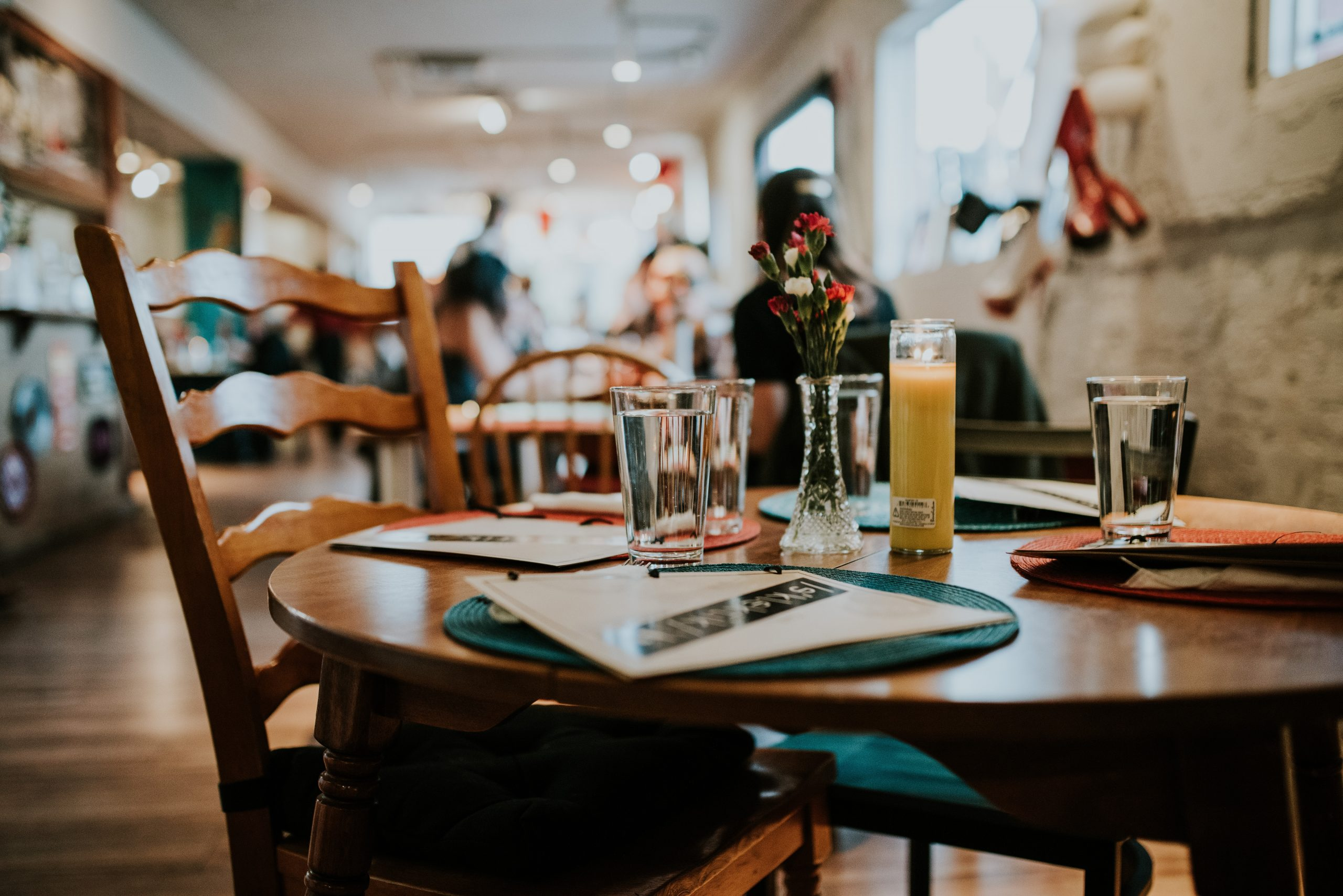 paper of interview questions and documents on the restaurant table